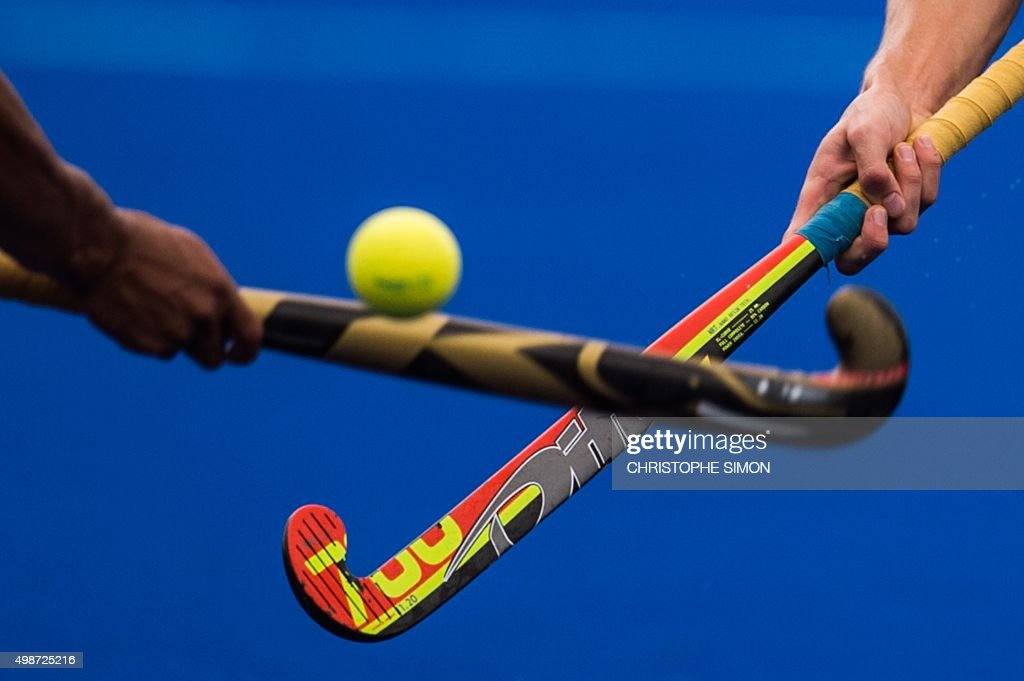 A Brazilian and a Mexican player take part in the Rio 2016 Olympic Games hockey on grass test event in Rio de Janeiro Brazil on November 25 2015 /...