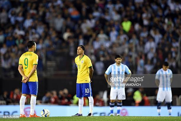 Brazilian and Argentinian football team players attend a minute of silence in honor of victims of attacks that left at least 120 dead in France...