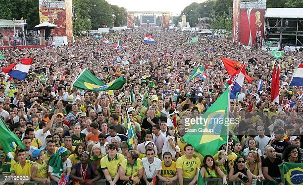 Brazilian and Croatian soccer fans watch the Croatia vs Brazil World Cup 2006 match at an openair giant viewing screen in front of the Brandenburg...