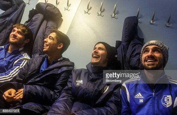 Brazilian and Slovakian players of Slovakian football club FC STK Samorin laugh in the locker room after victory in a friendly soccer match against...