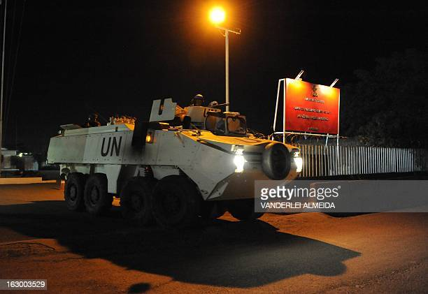 A Brazilian APC of the MINUSTAH force exits the military base to patrol in a shantytown in PortauPrince on March 3 2013 Brazil began the process of...