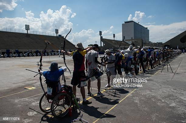 Brazilian archers set their position during the 40th Brazilian Archery Championship at the Sambadrome in Rio de Janeiro Brazil on October 30 2014 The...