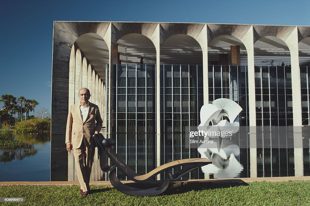 Brazilian architect <a gi-track='captionPersonalityLinkClicked' href=/galleries/search?phrase=Oscar+Niemeyer&family=editorial&specificpeople=161539 ng-click='$event.stopPropagation()'>Oscar Niemeyer</a> (1907 - 2012) poses outside the Mondadori headquarters in Segrate, a comune in Milan, Italy, circa 1975. He is responsible for the design of the building.