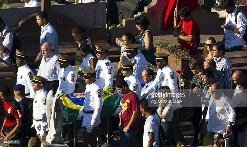 Brazilian architect Oscar Niemeyer's coffin is carried at Sao Joao Batista cementery in Rio de Janeiro, Brazil on December 7, 2012. Niemeyer, the Brazilian icon who revolutionized modern architecture and designed much of the country's futuristic capital Brasilia, died at 104.