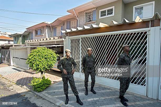 Brazilian army soldiers check residences during an operation to fight the Aedes aegypti mosquito vector of the Zika Dengue ans Chikungunya viruses in...