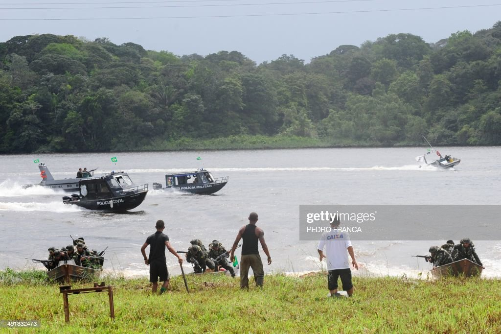 Brazilian Army soldiers deploy at the Oiapoque river border between Brazil and French Guyana during a drill as part of the Agata 8 Operation which...