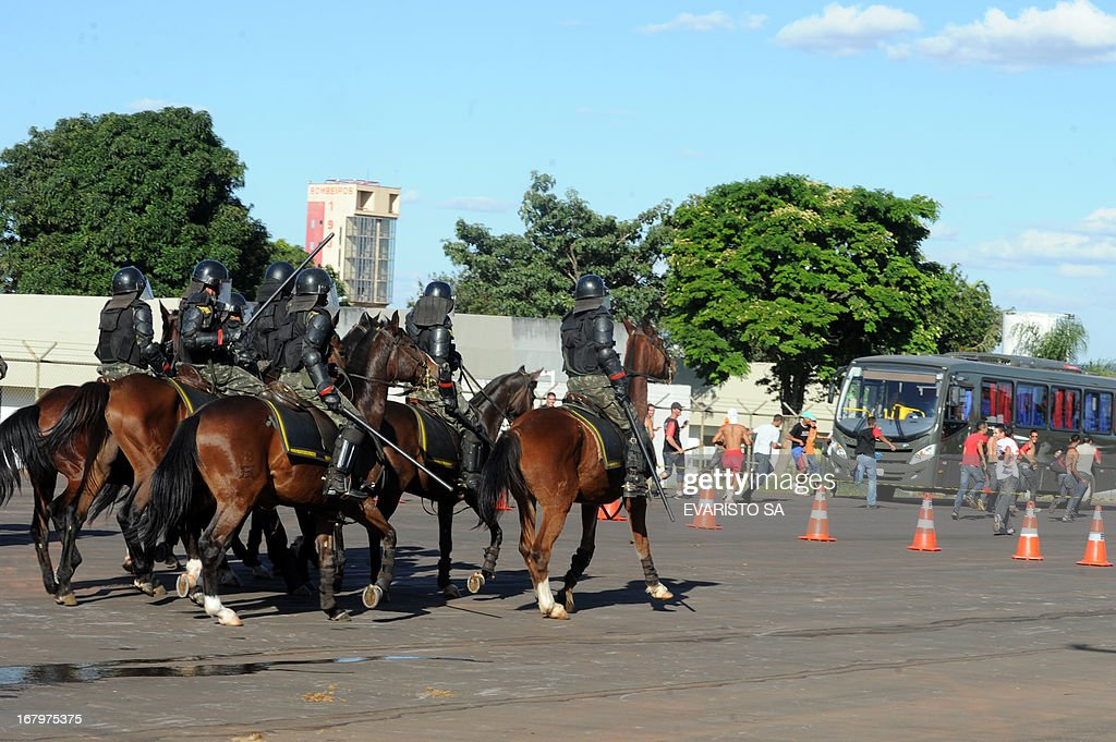 Brazilian Army soldiers mounted and in riot gear conduct a drill at the Fire Department headquarters in Brasilia, on May 3, 2013, as part of the security measures ahead of the Confederation Cup which will be held next June for the 2014 FIFA World Cup and the 2016 Olympics Games. AFP PHOTO / Evaristo SA