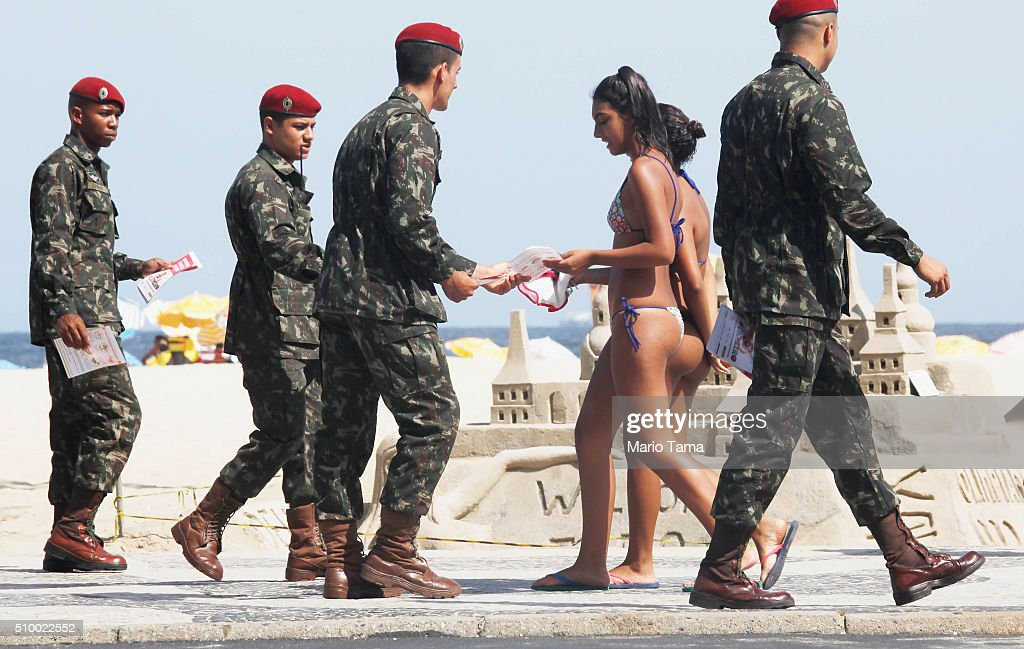 Brazilian Army soldiers pass out pamphlets on Copacabana beach warning of the dangers of the Zika virus and how to protect against mosquitos on February 13, 2016 in Rio de Janeiro, Brazil. 220,000 Brazilian military troops were deployed today in a mobilization across country to warn of the dangers of the mosquito-borne virus which may be linked to microcephaly.