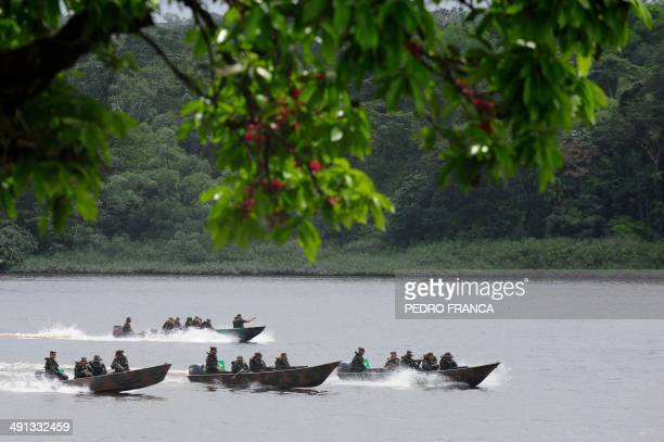 Brazilian Army soldiers patrol with boats the Oiapoque River border between Brazil and French Guyana as part of the Agata 8 Operation which aims to...