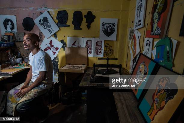 Brazilian artist D'Julia Gangary works in his atelier at the 'Ocupa Ouvidor 63' building in Sao Paulo Brazil on June 28 2017 A group of about one...