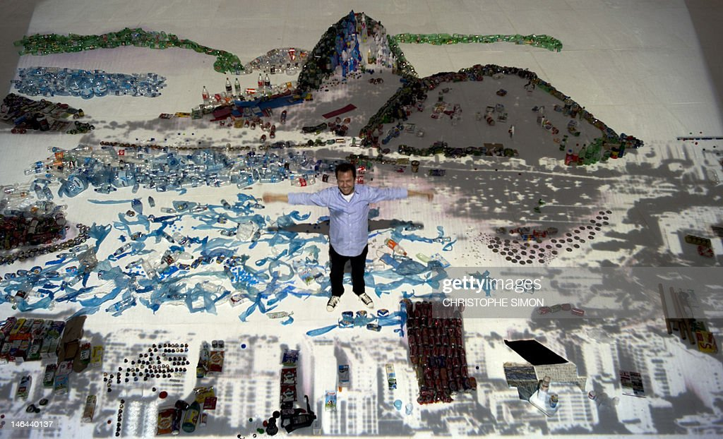Brazilian artist Vik Muniz is seen with his work made of trash, portraying the sugar loaf in Rio de Janeiro, on June 16, 2012. The UN conference, which marks the 20th anniversary of the Earth Summit -- a landmark 1992 gathering that opened the debate on the future of the planet and its resources -- is the largest ever organized, with some 50,000 delegates. AFP PHOTO / Christophe Simon