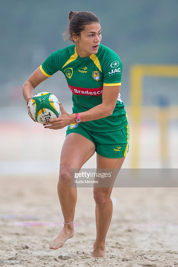 Brazilian athlete plays rugby on a newly opened rugby field at Copacabana Beach which will remain available until the Rio 2016 Olympic Games on June...