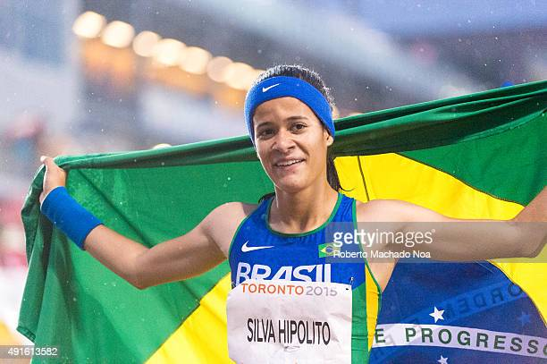 Brazilian athlete Veronica Silva Hipolito rejoicing after winning the event by holding the Brazilian National flag during the 2015 Parapan American...