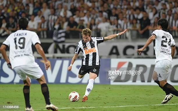 Brazilian Atletico Mineiro's Bernard kicks the ball during their Libertadores Cup second leg football match against Paraguayan Olimpia at the...