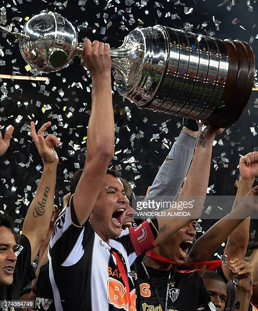 Brazilian Atletico Mineiro's captain Rever holds up the Libertadores Cup after the second leg final football match against Paraguayan Olimpia at the...