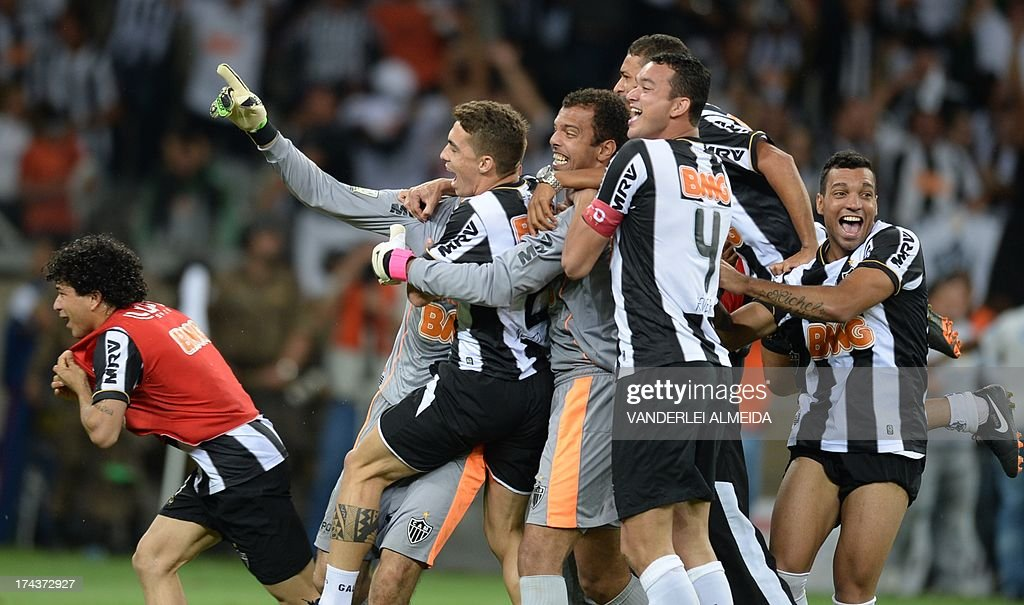 Brazilian Atletico Mineiro's players celebrate after winning their Libertadores Cup second leg final football match against Paraguay's Olimpia in a penalty shoot-out at the Mineirao stadium in Belo Horizonte, Brazil on July 24, 2013. AFP PHOTO / VANDERLEI ALMEIDA