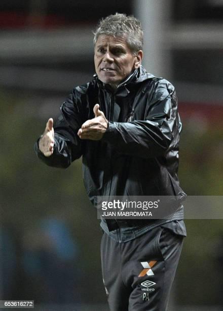 Brazilian Atletico Paranaense's coach Paulo Autuori gestures during their Copa Libertadores 2017 group 4 football match against Argentina's San...