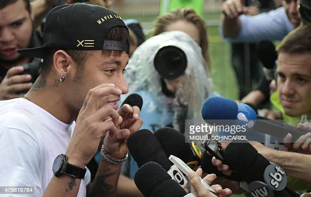 Brazilian Barcelona player Neymar gestures during an event with children with different capabilities and professional athletes taking part in the...