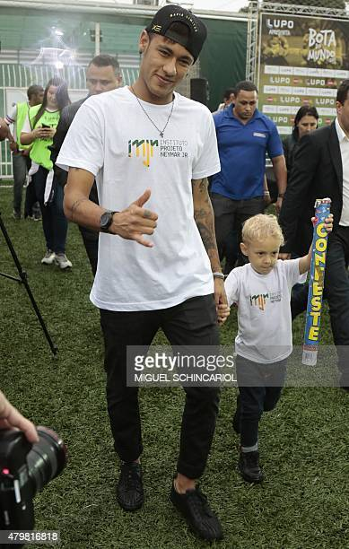 Brazilian Barcelona player Neymar poses with his son Davi Lucca during an event with children with different capabilities and professional athletes...