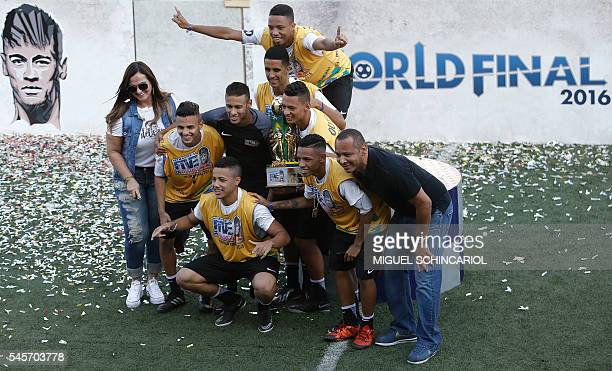Brazilian Barcelona player Neymar poses with the team and his father former footballer Neymar Senior after a fiveaside football match as part of a...