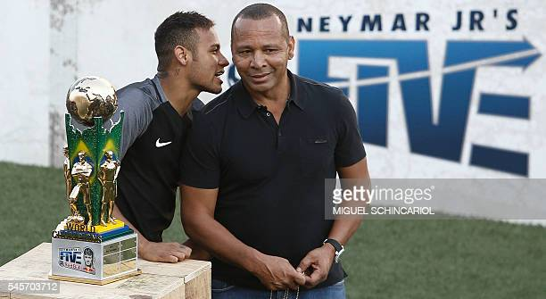 Brazilian Barcelona player Neymar speaks to his father former footballer Neymar Senior during a fiveaside football match as part of a Neymar Junior...