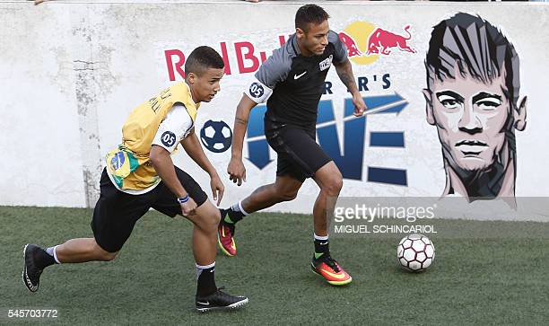 Brazilian Barcelona player Neymar takes part in a fiveaside football match as part of a Neymar Junior Institute project in Praia Grande Sao Paulo...