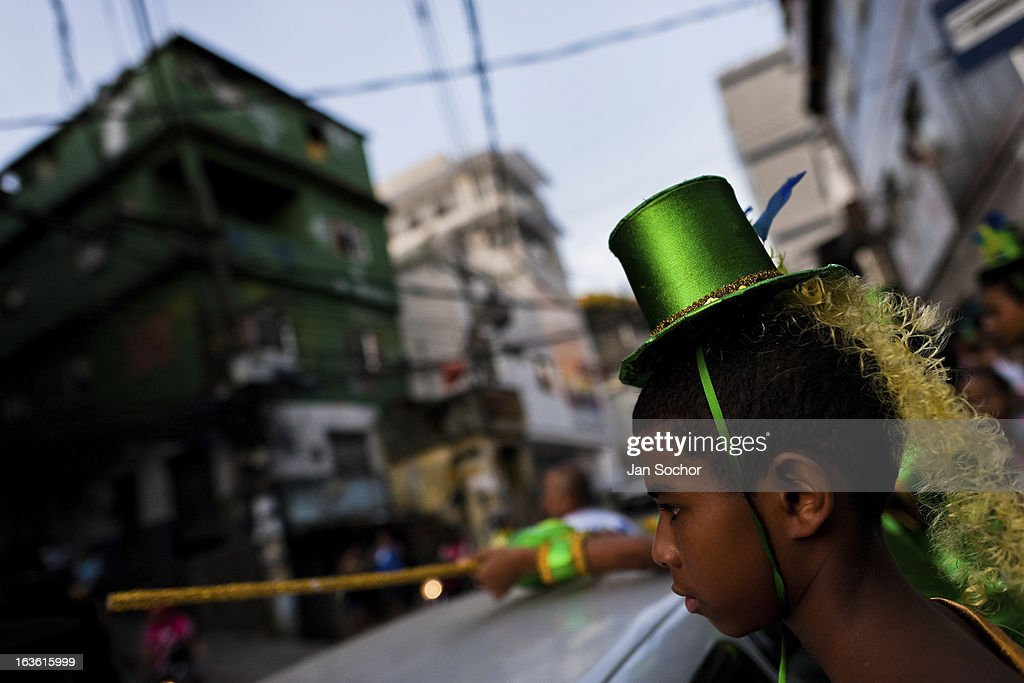 Brazilian boy, wearing a colorful costume, takes part in the Carnival parade in the favela of Rocinha, on 20 February 2012 in Rio de Janeiro, Brazil. Rocinha, the largest shanty town in Brazil and one of the most developed in Latin America, has its own samba school called GRES Academicos da Rocinha. The Rocinha samba school is very loyal to its neighborhood. Throughout the year, the entire community actively participate in rehearsals, culture events and parades related to the carnival.