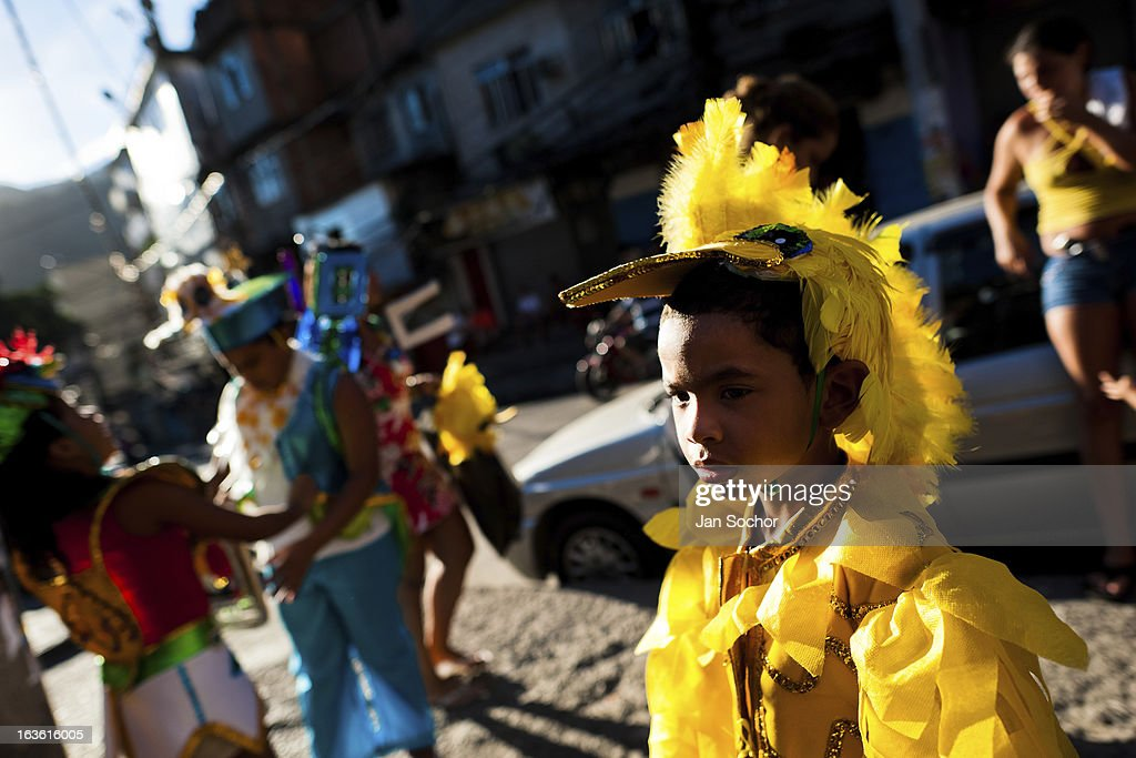 Brazilian boy, wearing a yellow bird costume, takes part in the Carnival parade in the favela of Rocinha, on 20 February 2012 in Rio de Janeiro, Brazil. Rocinha, the largest shanty town in Brazil and one of the most developed in Latin America, has its own samba school called GRES Academicos da Rocinha. The Rocinha samba school is very loyal to its neighborhood. Throughout the year, the entire community actively participate in rehearsals, culture events and parades related to the carnival.