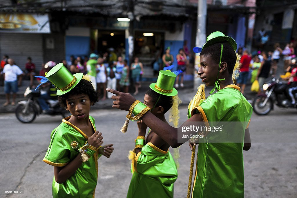 Brazilian boys, wearing green costumes, take part in the Carnival parade in the favela of Rocinha, on 20 February 2012 in Rio de Janeiro, Brazil. Rocinha, the largest shanty town in Brazil and one of the most developed in Latin America, has its own samba school called GRES Academicos da Rocinha. The Rocinha samba school is very loyal to its neighborhood. Throughout the year, the entire community actively participate in rehearsals, culture events and parades related to the carnival.