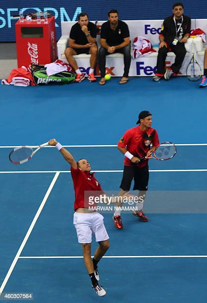 Brazilian Bruno Soares near his teammate Australian Layton Hewitt of the Singapore Slammers returns the ball to French Gael Monfis and Indian Rohan...