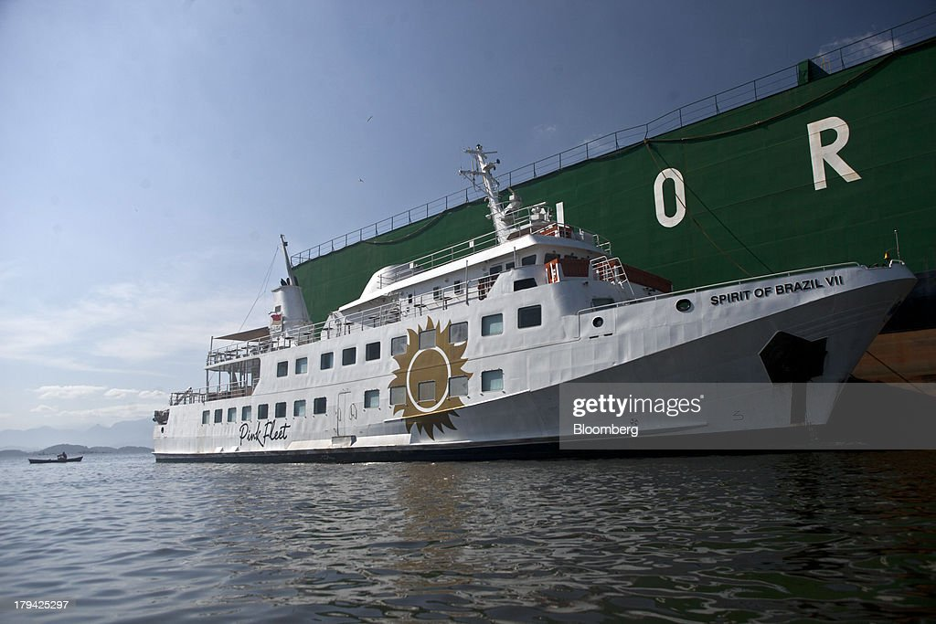 Brazilian businessman Eike Batista's yacht, registered as Spirit of Brazil VII and known as the Pink Fleet, sits anchored in the Cassinu shipyard in Sao Goncalo, Brazil, on Thursday, Aug. 29 , 2013. The Pink Fleet party boat has left Rio de Janeiros main marina, possibly for the scrap heap, as former billionaire Eike Batista unloads luxury assets and retracts from public view after his highly-publicized downfall. Photographer: Dado Galdieri/Bloomberg via Getty Images