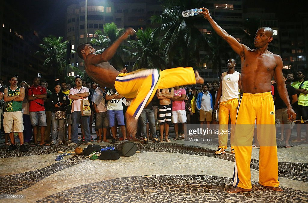 Brazilian capoeira artists perform for onlookers gathered ahead of the 2014 FIFA World Cup final on Copacabana Beach on July 12, 2014 in Rio de Janeiro, Brazil. Argentina faces Germany in the final tomorrow with up to 100,000 Argentine fans expected in Rio.
