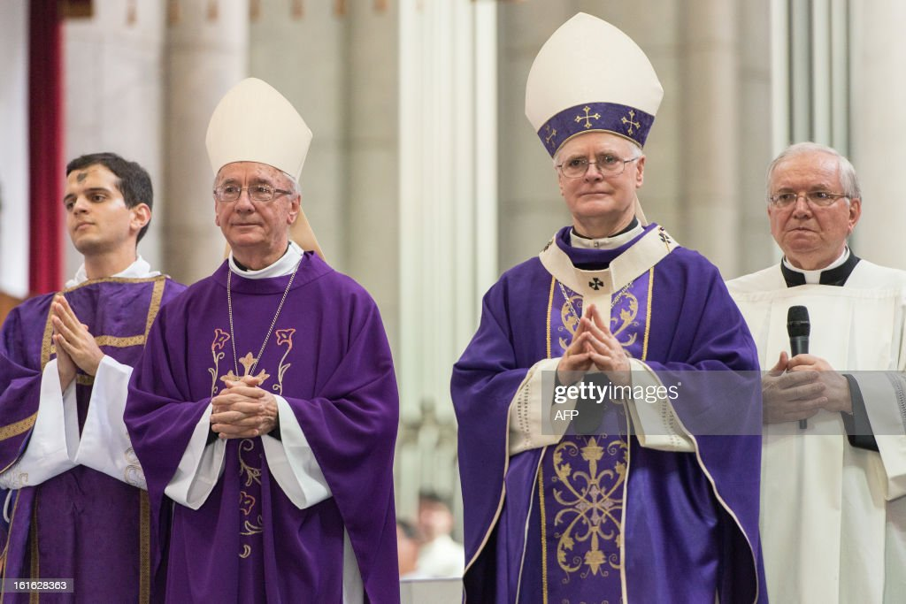 Brazilian Cardinal and Archbishop of Se Cathedral Odilo Pedro Scherer (2nd R), and Brazilian Cardinal Claudio Hummes (2nd L) --both considered in the running to be the future pope-- celebrate the Ash Wednesday mass at Se Cathedral in Sao Paulo, Brazil, on Februrary 13, 2013. Benedict XVI, the German-born leader of the world's 1.1 billion Catholics, made the shock announcement that he would resign on February 28 due to old age. Scherer, ordained cardinal by Benedict XVI in 2007 and who heads Brazil's largest archdiocese with five million Catholics, said in a press conference that nationality and age should not be key factors in choosing who will succeed Benedict XVI. AFP PHOTO / Yasuyoshi CHIBA