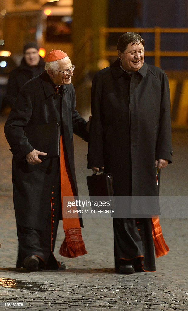 Brazilian cardinal Joao Braz de Aviz (R) walks after a meeting of a conclave to elect a new pope on March 4, 2013 at the Vatican. The Vatican meetings will set the date for the start of the conclave this month and help identify candidates among the cardinals to be the next leader of the world's 1.2 billion Catholics. AFP PHOTO/ Filippo MONTEFORTE