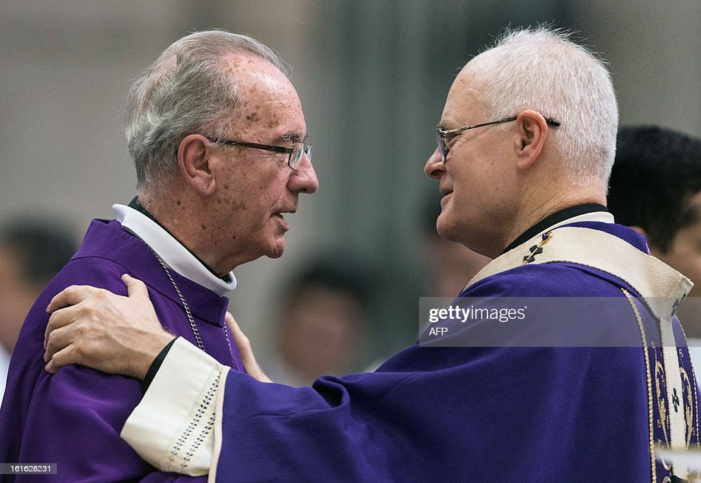 Brazilian Cardinal Odilo Pedro Scherer (R), Archbishop of Se Cathedral greets Brazilian Cardinal Claudio Hummes --both considered in the running to be the future pope-- during the Ash Wednesday mass at Se Cathedral in Sao Paulo, Brazil, on Februrary 13, 2013. Benedict XVI, the German-born leader of the world's 1.1 billion Catholics, made the shock announcement that he would resign on February 28 due to old age. Scherer, ordained cardinal by Benedict XVI in 2007 and who heads Brazil's largest archdiocese with five million Catholics, said in a press conference that nationality and age should not be key factors in choosing who will succeed Benedict XVI. AFP PHOTO / Yasuyoshi CHIBA
