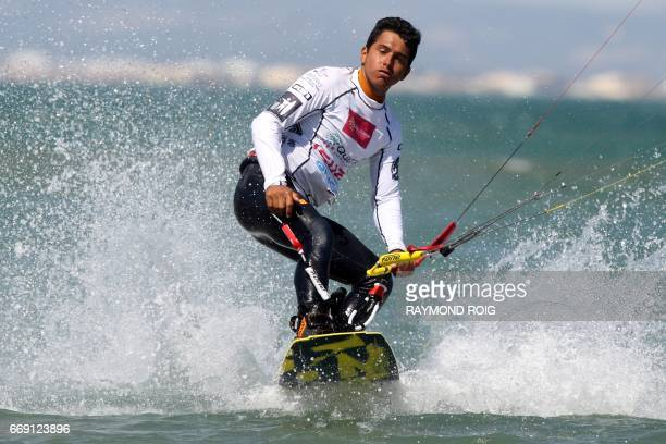 Brazilian Carlos Mario competes in the Mondial du Vent or World Wind kitesurfer competition part of the World Cup Kitesurf Freestyle WKL 2017 at La...