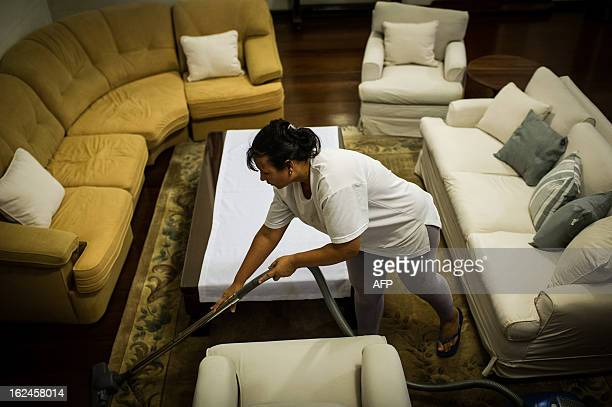 Brazilian Cassia Mendes who has been working as a housekeeper for more than 20 years cleans a house in Sao Paulo Brazil on Februrary 19 2012 Brazil...