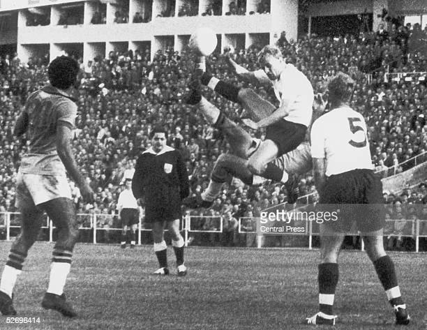Brazilian centre Jose Juan Altafini aka Mazzola and England back Don Howe collide in the air during the EnglandBrazil World Cup match at Gothenburg...