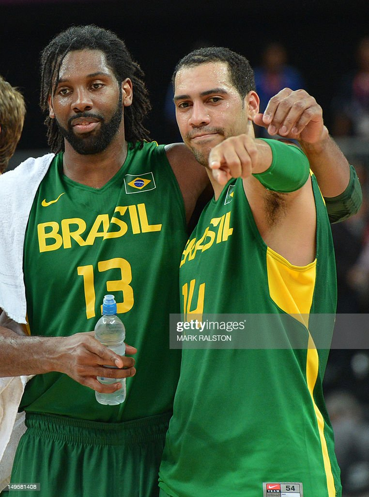 Brazilian centre Nene Hilario (L) and Brazilian guard Marquinhos Vieira Sousa celebrate at the end of the Men's preliminary round group B basketball match of the London 2012 Olympic Games Great Britain vs Brazil on July 31, 2012 at the basketball arena in London. Brazil won 67 to 62.