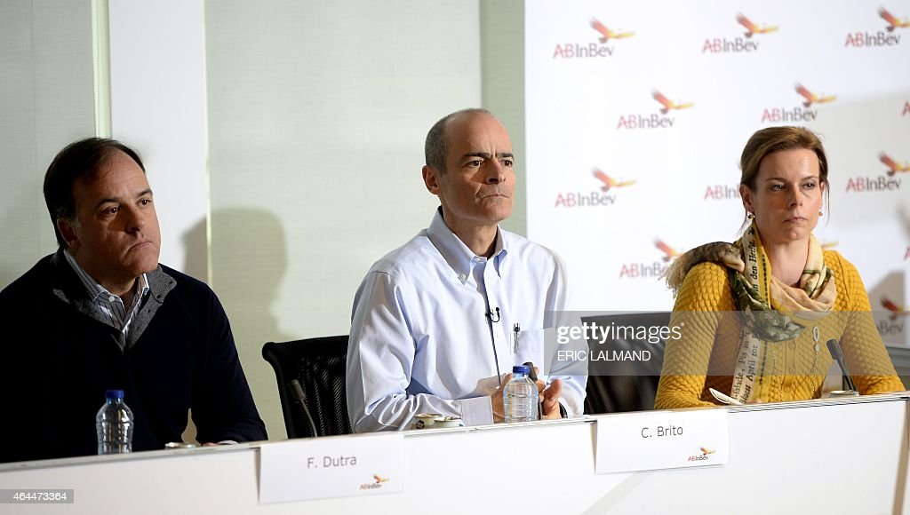 Brazilian CFO of multinational beverage and brewing company Anheuser-Busch InBev Felipe Dutra, Brazilian CEO <a gi-track='captionPersonalityLinkClicked' href=/galleries/search?phrase=Carlos+Brito&family=editorial&specificpeople=5398616 ng-click='$event.stopPropagation()'>Carlos Brito</a> and Communication Director Marianne Amssoms give a press conference to present the company's 2014 results in Leuven on February 26, 2015.