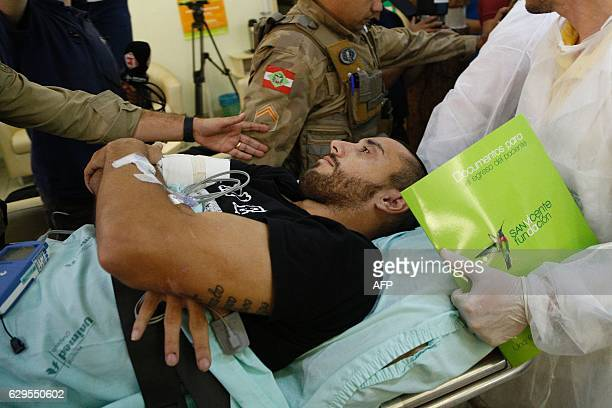 Brazilian Chapecoense footballer Alan Ruschel one of the survivors of the LaMia airliner air crash in Colombia two weeks ago arrives at hospital in...