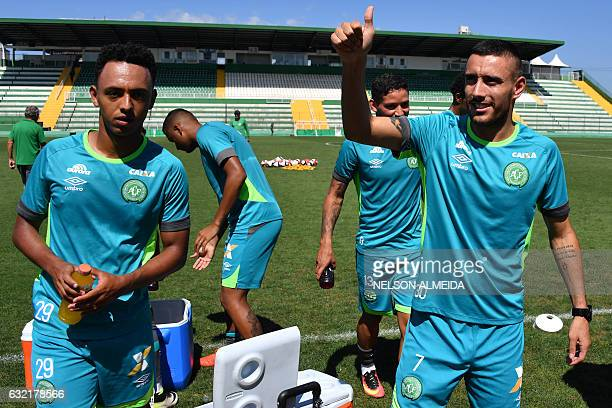 Brazilian Chapecoense footballer Alan Ruschel one of the survivors of the LaMia airplane crash in Colombia waves to supporters after a training...