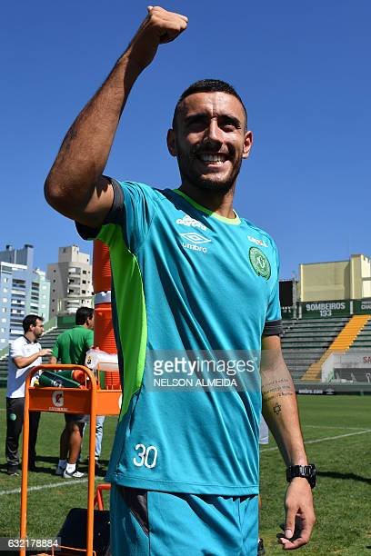Brazilian Chapecoense footballer Alan Ruschel one of the survivors of the LaMia airplane crash in Colombia gestures to supporters after a training...