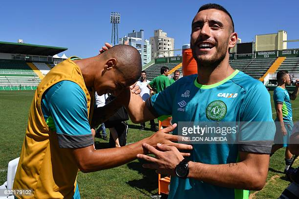 Brazilian Chapecoense footballer Alan Ruschel one of the survivors of the LaMia airplane crash in Colombia jokes with Wellington Paulista after a...
