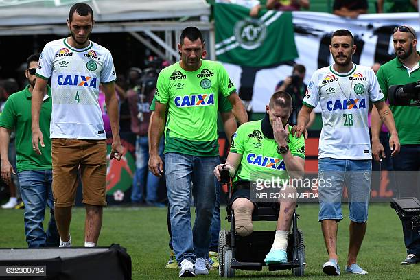 Brazilian Chapecoense footballers Helio Neto Jackson Follmann and Alan Ruschel survivors of the LaMia airplane crash in Colombia arrive at the Arena...