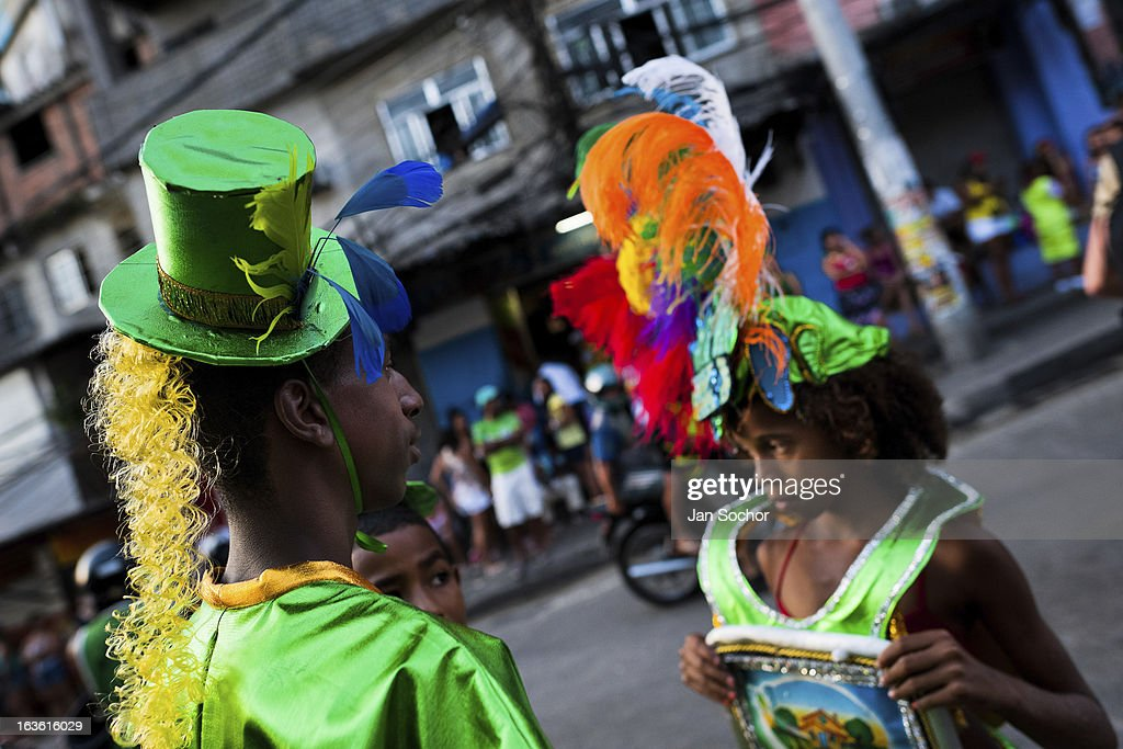 Brazilian children, wearing colorful costumes, take part in the Carnival parade in the favela of Rocinha, on 20 February 2012 in Rio de Janeiro, Brazil. Rocinha, the largest shanty town in Brazil and one of the most developed in Latin America, has its own samba school called GRES Academicos da Rocinha. The Rocinha samba school is very loyal to its neighborhood. Throughout the year, the entire community actively participate in rehearsals, culture events and parades related to the carnival.
