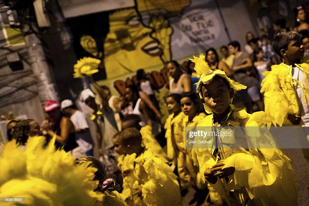 Brazilian children, wearing yellow bird costumes, take part in the Carnival parade in the favela of Rocinha, on 20 February 2012 in Rio de Janeiro, Brazil. Rocinha, the largest shanty town in Brazil and one of the most developed in Latin America, has its own samba school called GRES Academicos da Rocinha. The Rocinha samba school is very loyal to its neighborhood. Throughout the year, the entire community actively participate in rehearsals, culture events and parades related to the carnival.