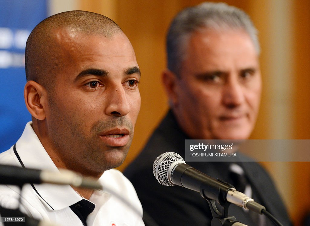 Brazilian club team Corinthians captain and forward Emerson (L) answers a question beside head coach Tite (R) during the team's press conference at a hotel in Nagoya, Aichi prefecture while participating in the FIFA Club World Cup in Japan 2012 on December 7, 2012. The ninth edition of the FIFA Club World Cup football tournament is taking place from December 6 to 16.