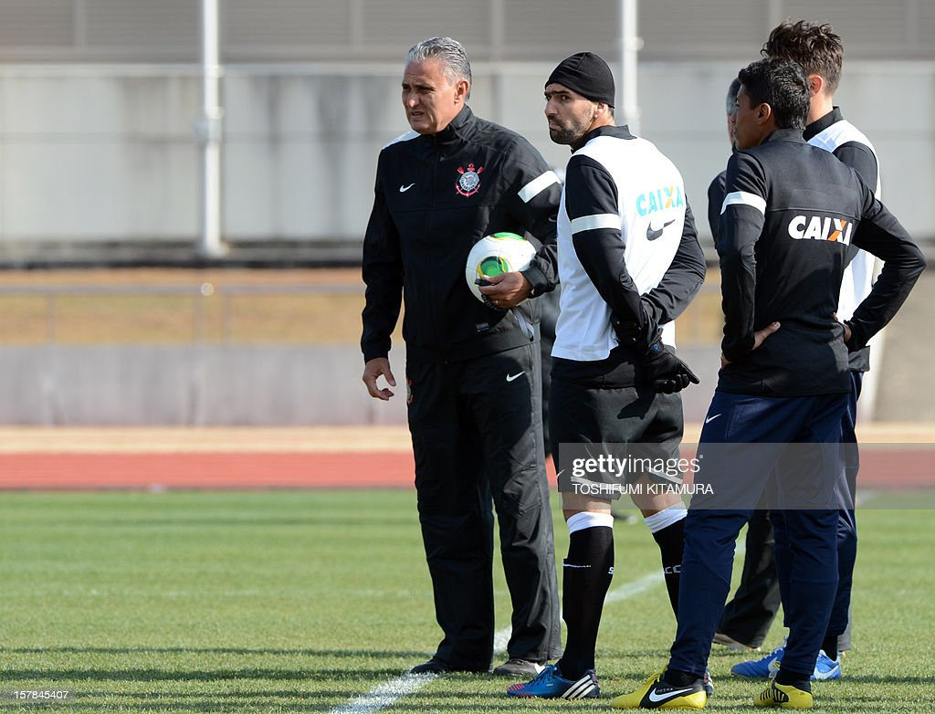 Brazilian club team Corinthians head coach Tite (L) and his players stand on the pitch during the team's training in Kariya, Aichi prefecture while participating in the FIFA Club World Cup in Japan 2012 on December 7, 2012. The ninth edition of the FIFA Club World Cup football tournament is taking place from December 6 to 16.