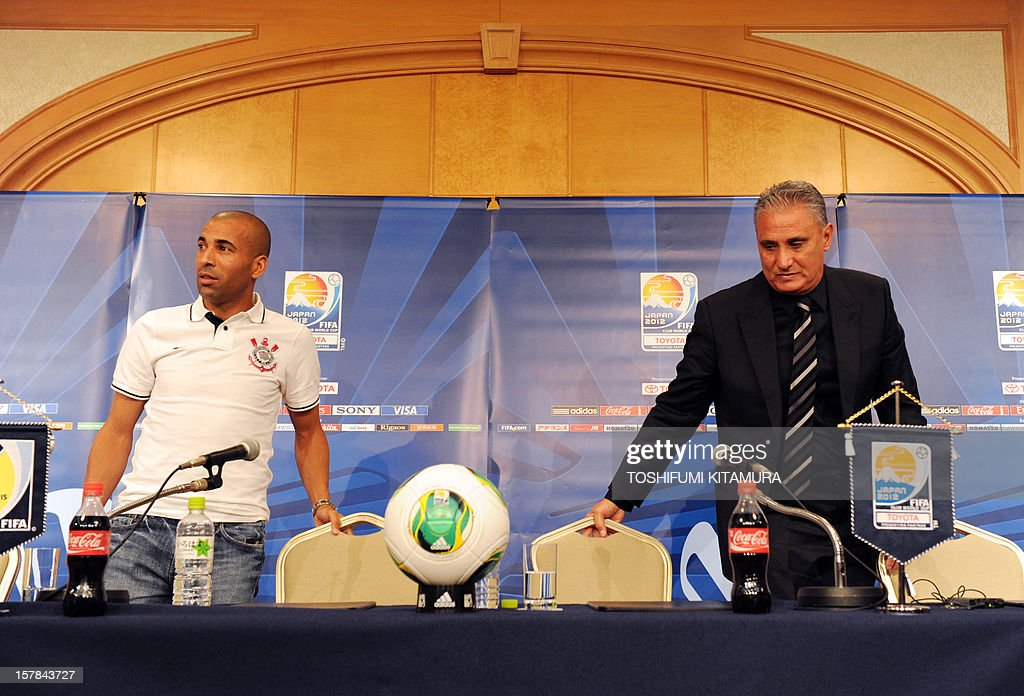 Brazilian club team Corinthians head coach Tite (R) and his team's captain and forward Emerson (L) leave the room after their press conference at a hotel in Nagoya, Aichi prefecture while participating in the FIFA Club World Cup in Japan 2012 on December 7, 2012. The ninth edition of the FIFA Club World Cup football tournament is taking place from December 6 to 16.